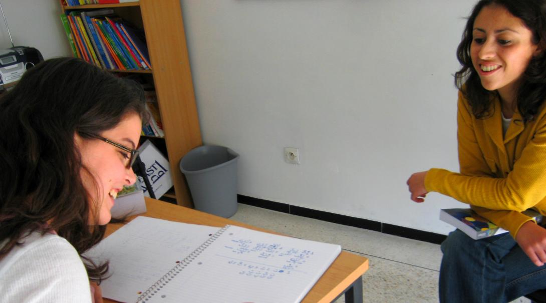 As part of her cultural exchange program abroad, a volunteer learns a new language.